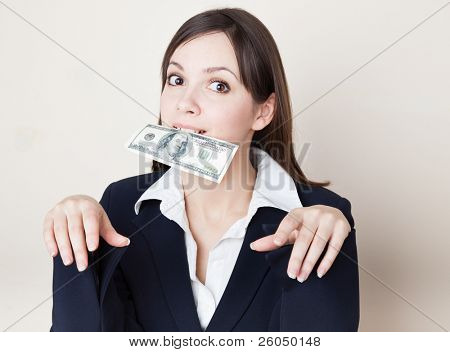 Young brunette woman with 100 dollars in her mouth