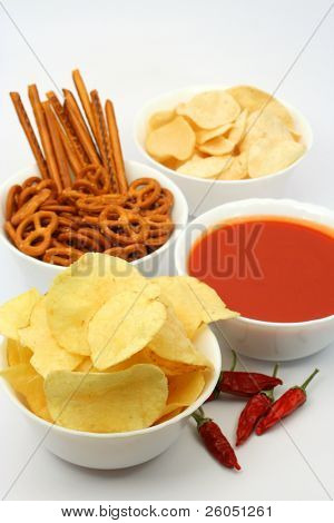 Salty snacks, potato chips and tomato dipping sauce