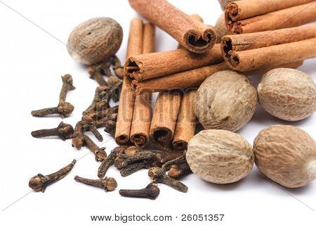 Nutmeg, cloves and cinnamon sticks on white background