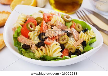 Classic tuna salad with pasta, olives and tomato