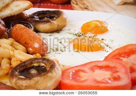 Fried eggs, beans, sausage and mushrooms, traditional english breakfast food