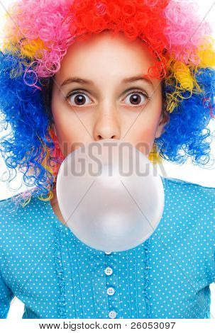 Young girl with clown wig and bubble gum isolated on white