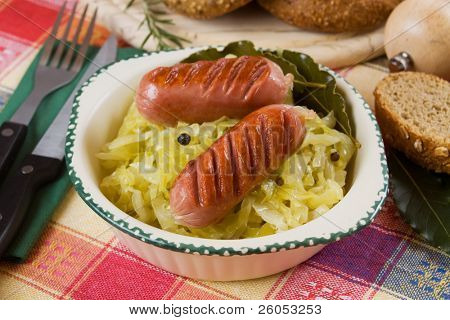 Grilled sausage and cooked sauerkraut, traditional german food