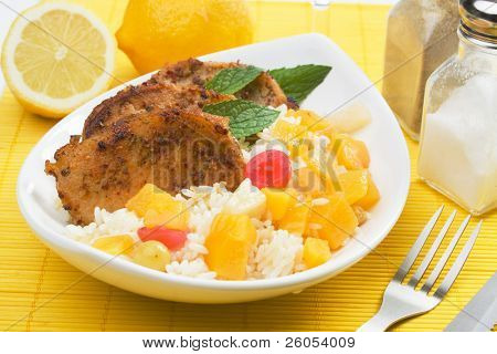 Caribbean style spicy pork loin chops with tropical fruit