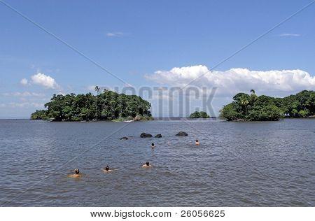 people swimming in the lake  nicaragua