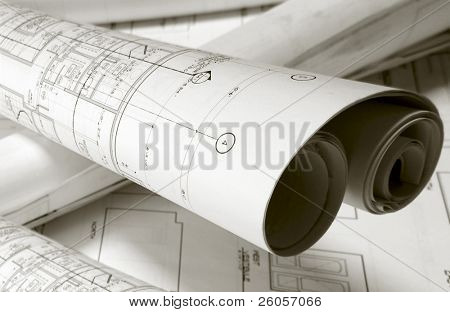 roled -up plans on the table