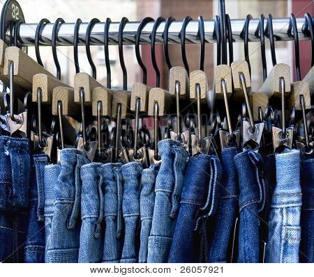 blue jeans on a rack