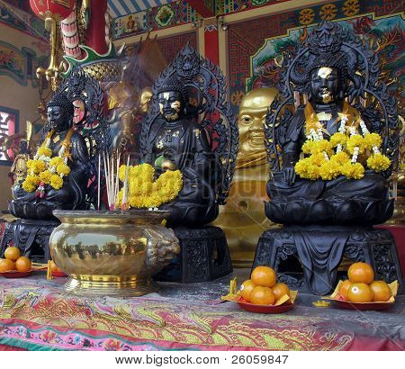three buddah s in a chinaes temple  thailand