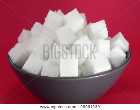 bowel of sugar  tubes   with red background