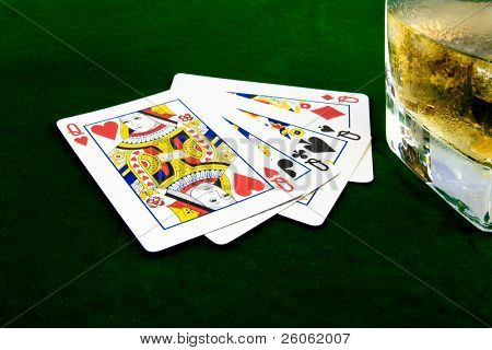 playing cards and whiskey