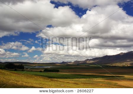 Rocky Landscape With Blue Cloudy Sky