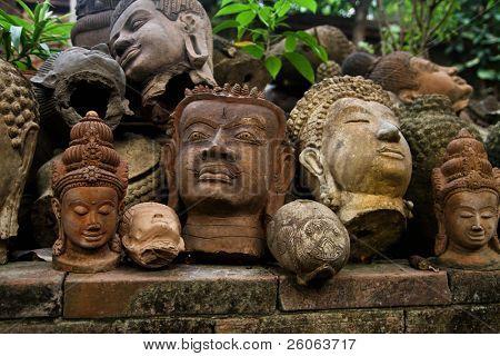 old   terracotta   Buddah heads