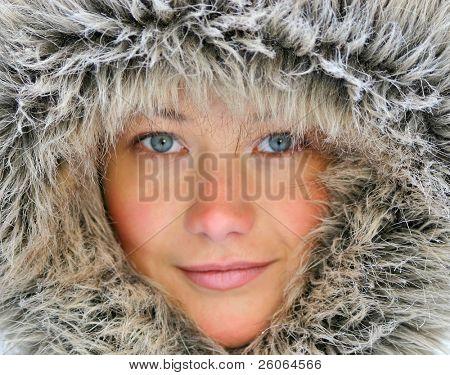 Beaytiful girl with blue eyes in fur hood