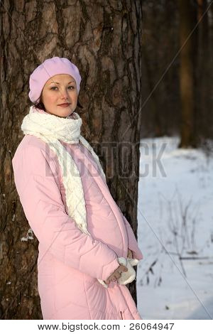 beautiful smiling pregnant young woman in pink beret