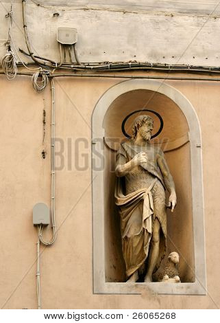 Statue of Jesus Christ, power and telephone lines.