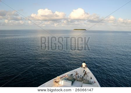 A man in a boat heading to remote uninhibited island