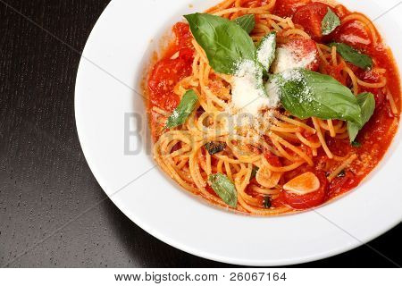 Freshly cooked plate of spaghetti with tomato sauce and oregano