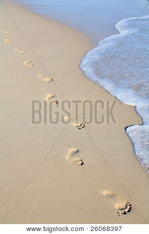 Footprints on beach sand