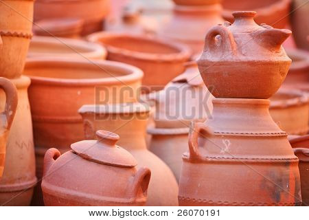 Clay pots and kitchenware on the village fair in Morocco