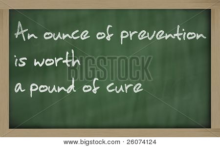 """ An Ounce Of Prevention Is Worth A Pound Of Cure "" Written On A Blackboard"