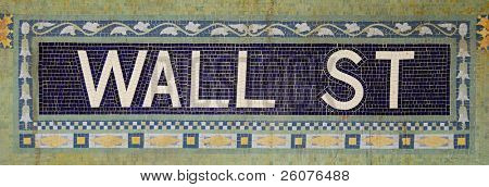 New York City Wall Street station name tile pattern in subway station.