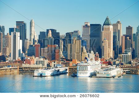 Modern Urban Buildings. New York City Manhattan skyline over Hudson river with boats and skyscrapers.