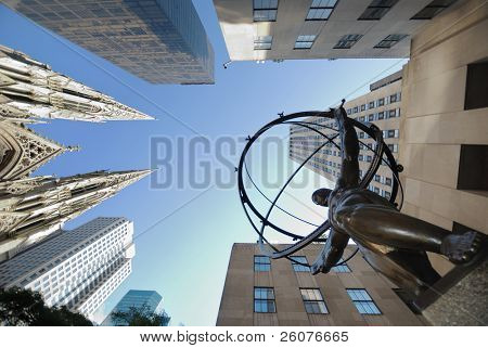 NEW YORK CITY - SEP 5: Fifth Avenue, as a symbol of wealthy New York, with Atlas statue and St. Patrick's Cathedral, September 5, 2009 in Manhattan, New York City.