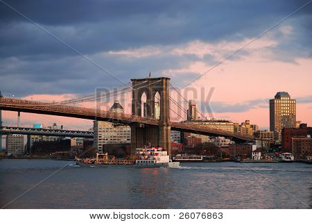 New York City Brooklyn Bridge with Manhattan skyline panorama at sunset