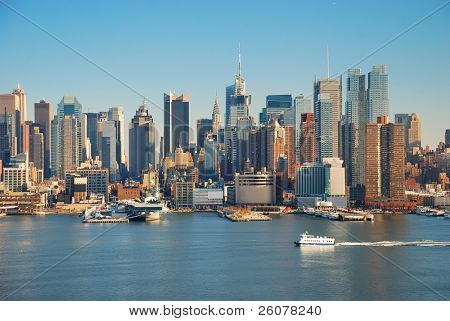 Urban metropolis city skyline, Manhattan with Empire State Building, New York City over Hudson River with boat and pier.