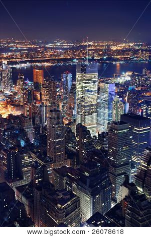 New York City Manhattan Times Square panorama aerial view at night with office building skyscrapers skyline illuminated by Hudson River.