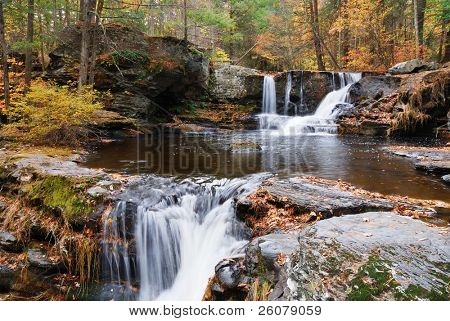 Waterfall with trees and rocks in mountain in Autumn. From Pennsylvania Dingmans Falls.