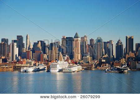 Urban City Skyline, New York City over Hudson River with boat and pier.