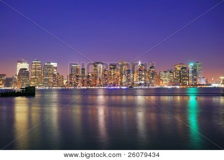 Hudson River at dusk, New York City, with lights in offices buildings of downtown Manhattan.