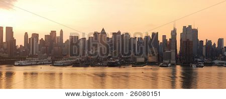 Manhattan urban skyline silhouette panorama in New York City at sunrise over Hudson River