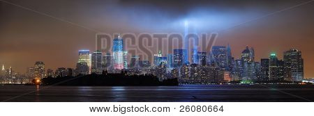 NEW YORK CITY, NY - SEP 11: City night view with light beam on September 11, 2011 in Manhattan, New York City. Light beams are lit at the site in memory of World Trade Center.