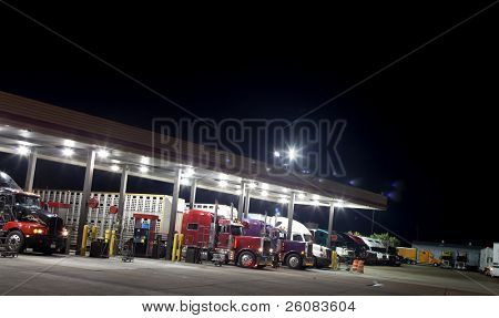 Truck stop at night getting diesel