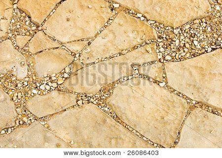 Natural stone texture with cracks and gravel