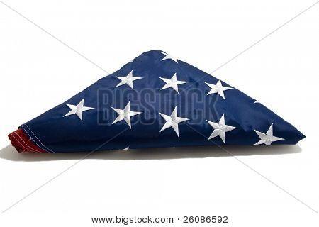 American flag folded on white background