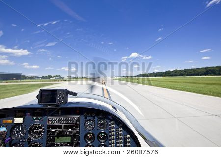 View from small aircraft taking off from runway