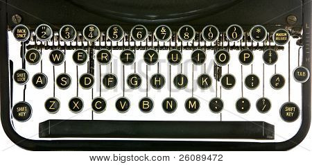 Vintage typewriter keyboard, backlit on white. Includes alphabet, numerals, shift key, backspacer, and tabulator.