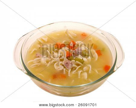 Glass bowl of chunky chicken noodle soup.