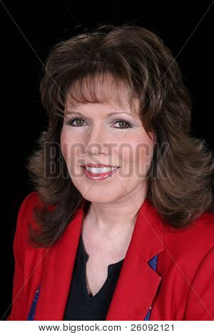 Hermosa mujer mayor de negocios con una mirada de éxito y realización.