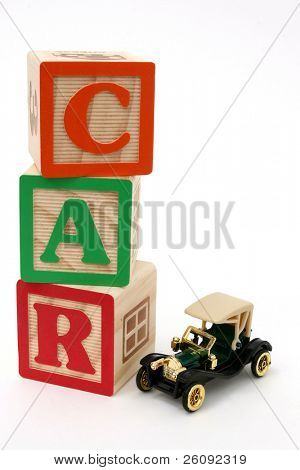 ABC blocks spelling car and black antique car.