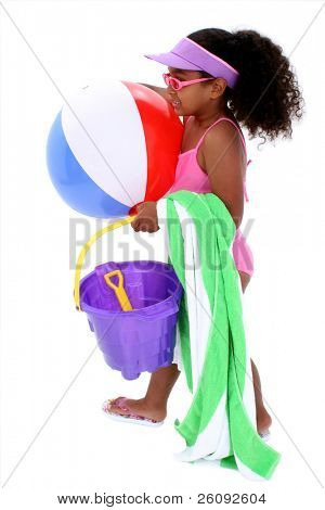 Adorable Young Girl Ready for the Beach.  With sun visor, sunglasses, beach ball and towel.