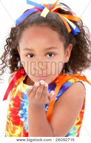 Beautiful Young Girl In Tie Die Outfit Blowing A Kiss.