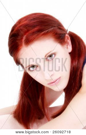 Beautiful 17 year old girl with long red hair over white.
