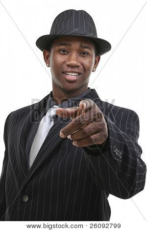 Attractive Business Man In Pin Striped Suit & Hat Pointing To Camera.