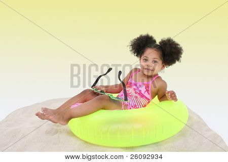 Beautiful Young Girl Laying In the Sand in pink swimsuit/hula skirt.  Beautiful eyes.
