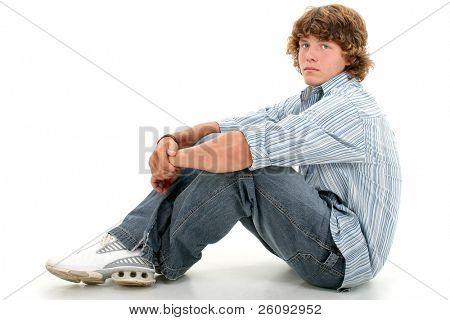 Attractive Sixteen Year Old Teen Boy In Casual Clothes Over White.  Light brown curly hair and hazel eyes.