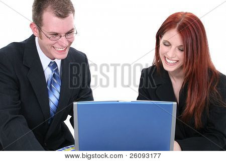 Man and woman in business suits working on laptop computer. Shot in studio over white.
